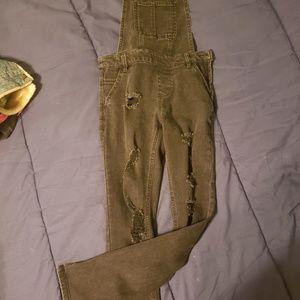 Black distressed skinny overalls